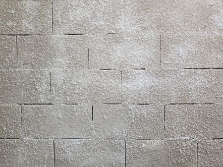 Old grey stone masonry wall texture made of foam blocks or airblocks. Abstract surface plastered. Grunge, weathered construction structure.