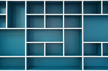 Empty closet shelves background. Modern wooden wardrobe boxes, beautiful blue and white frame interior design combination, abstract shape and patterns.