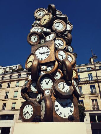 LHeure de Tous monument, Art sculpture made of clocks at Saint-Lazare train station, Paris France. Popular tourist landmark as time of everybody concept, showing different hours.