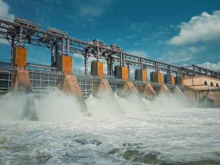 Hydropower Plant on the Nistru river in Dubasari (Dubossary), Moldova. Hydro power station, water dam, renewable electric energy source, industrial concept. Global environmental problems.