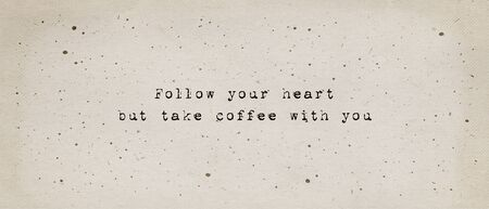 Follow your heart, but take coffee with you. Funny caffeine addiction text art illustration, minimalist typewriter font style written on old paper texture. Creative banner, trendy vintage style design