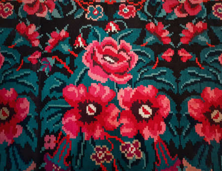 Moldavian national woven carpet, traditional floral pattern. Handcrafted vintage style rug, cultural symbol of Moldova and Romania folklore. Red flowers ornament, retro stitch. Ethnic textile motif. Zdjęcie Seryjne