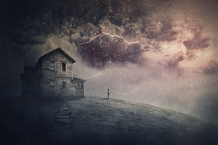 Creepy storm scene with scary lightnings over a ghost land with a haunted house and a person phantom standing under rain. Desolated mansion facing a hurricane. Spooky seasonal Halloween landscape