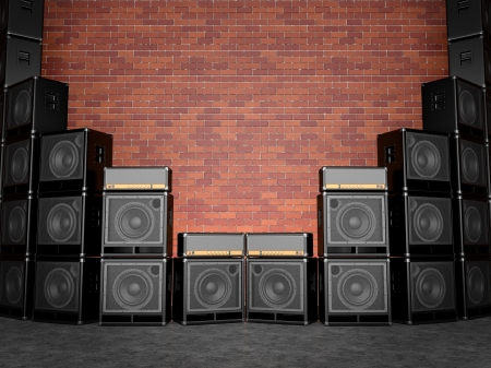 Guitar amps against a brick wall