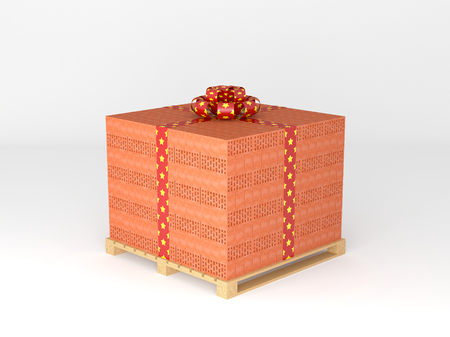 Stack of bricks on pallet, tied with gift ribbon photo