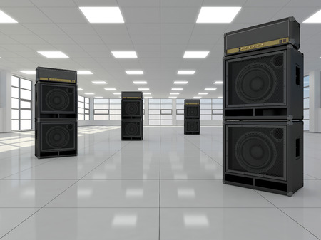 A large empty room in which there are guitar amps Stock Photo