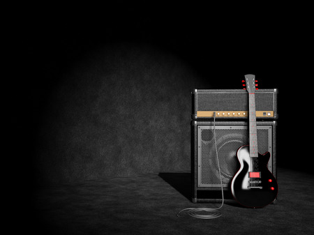 Electric guitar and guitar amplifier on wall background photo