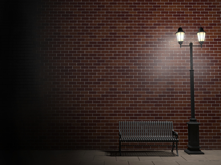 Night view of a brick wall, vintage street light and bench Stock Photo
