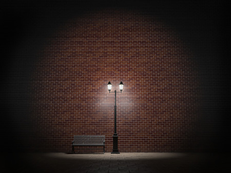 Night view of a brick wall, vintage street light and bench Stockfoto