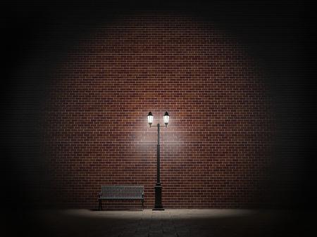 Night view of a brick wall, vintage street light and bench Standard-Bild