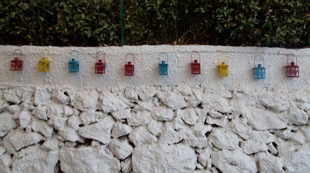 Photo of an old wall with a decor of multicolored lamps Standard-Bild