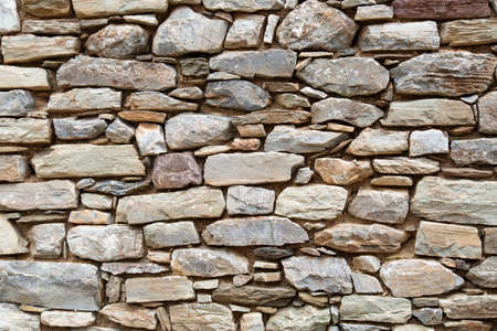 Photo of an ancient wall in Greece made of stone.