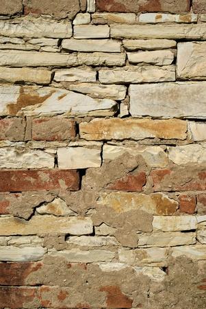 Close up of a brick and limestone stone wall  photo