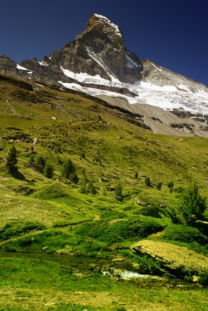 traditional climbing: views of the Matterhorn with greenery - Swiss Alps Stock Photo
