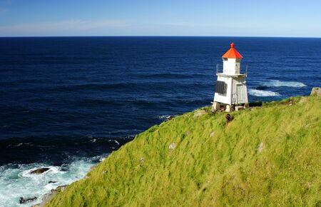 lighthouse on the coast of Lofoten, Norway Stock Photo