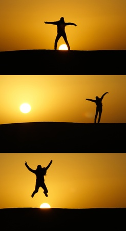 Leaping silhouettes at sunset in the desert Stock Photo