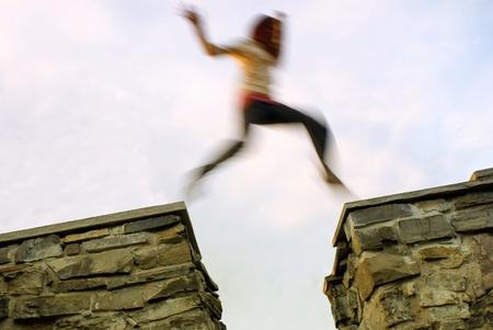 Girl jumps through the gap  Longer shutter time