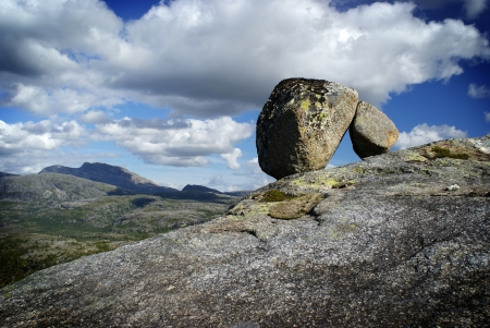 Two stones supporting each other Stock Photo