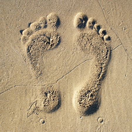 feet in sand: Two Footprints in sand