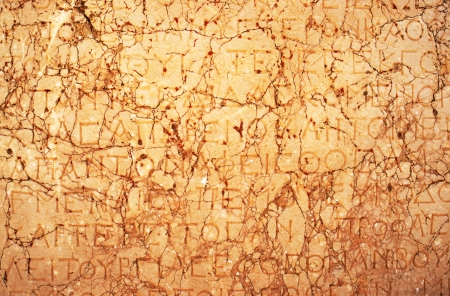 greek alphabet: Ancient greek text graved on marble stone slate Stock Photo