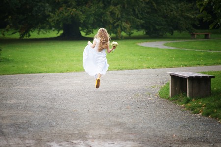 Young girl is running away photo