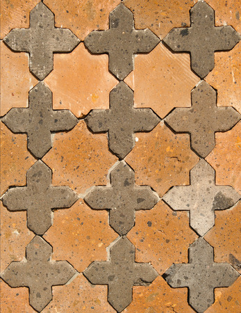 repetitious: Terracotta and black tuff ornamental wall detail on historic osman building in Ani, Turkey