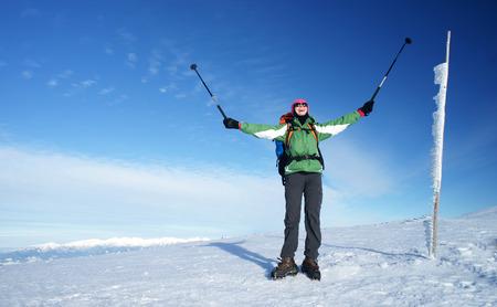 nordic ski: Happy woman on a mountain trip.