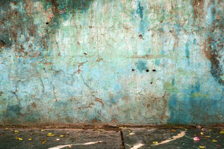 Dirty blue wall on a street