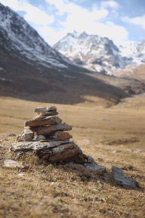 Rock cairn marking a hiking path Stock Photo