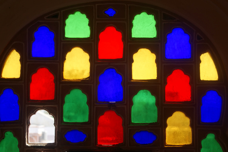 Colorful glass ornamental window in indian architecture Stock Photo