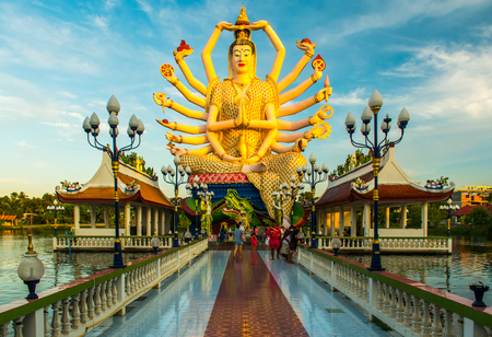 Wat Plai Laem Buddhist Temple statues during a sunset in Koh Samui, Surat Thani, Thailand