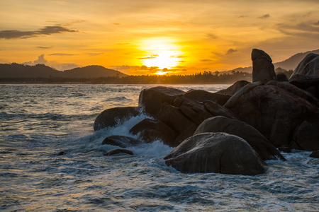 The Rock Hin Ta and Hin Yai from Thailand Island of Koh Samui. The picturesque pile of rocks on the beach, illuminated by the sunset.