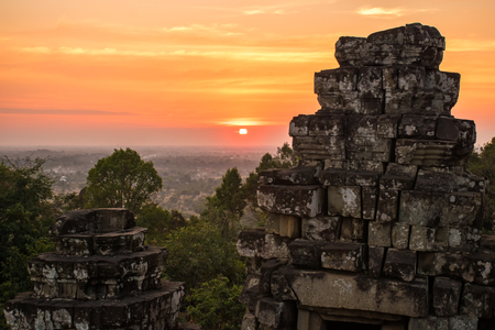 Sunset at Phnom Bakheng Temple in Angkor Wat Complex in Cambodia.