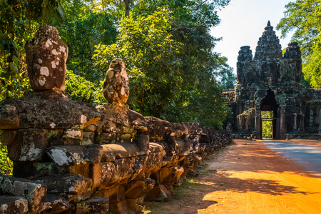 Antient Bridge with old statues in Angkor Wat comple in Cambodia Stock Photo
