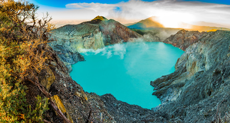 Panoramatic view on Kawah Ijen volcano with trees during beautiful sunrise in East Java in Indonesia