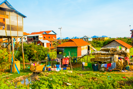 Colorful houses on stilts of floating village Phnom Krom, Tonle Sap in Cambodia