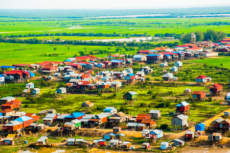 Floating village Phnom Krom, green rice fields in Tonle Sap, Siem Reap, Cambodia