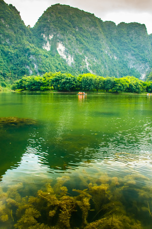 Lake reflection with mountains of Trang An Scenic Landscape, Ninh Binh in Vietnam