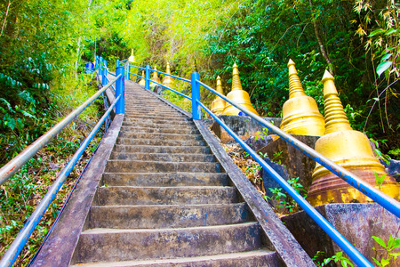 Stars and golden stupas in Tiger Cave Temple, Wat Tham Suea, Krabi in Thailand Фото со стока
