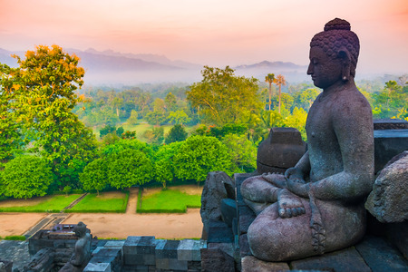 Buddha and beautiful view from ancient Buddhist temple complex Borobudur, Yogyakarta, Jawa in Indonesia