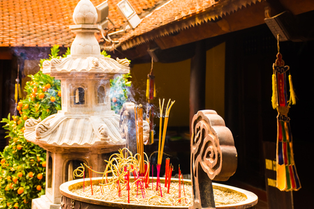 Incense sticks in the Buddhist Temple Tran Quoc Pagoda, Symbol of Hanoi in Vietnam
