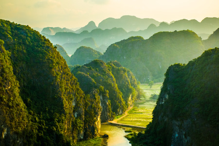 Beautiful sunset landscape viewpoint from the top of Mua Cave mountain, Ninh Binh, Tam Coc in Vietnam