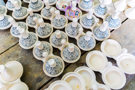 A moroccan pottery maker creates ceramics in a workshop in old medina of Fez, Morocco in Africa