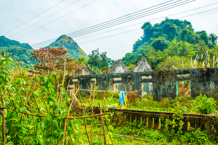 An old ruined farm building in the jungle of the Cat Ba National Park in Vietnam