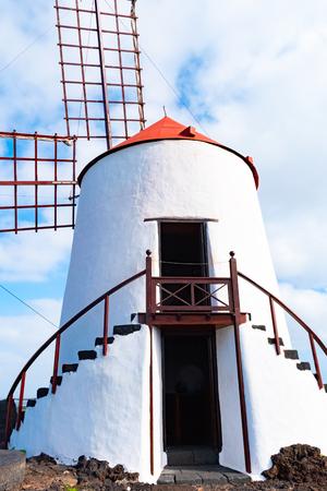 Typical White Windmill in Jardin Cactus garden, Guatiza village, Lanzarote, Canary islands, Spain.
