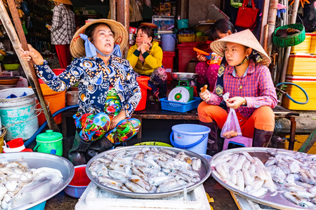 Vietnam, Phu Quoc Island, February 26 2018: Street Woman Vendor selling fresh fish in typical Vietnam sidewalk food market Editorial