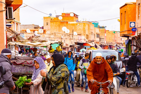 MARRAKECH, NOVEMBER 10 2018: Crowd of people at an old market in medina district in Marrakech