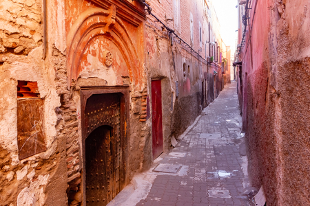 Colorful ancient old and narrow street in medina of Marrakech, Morocco, Africa Stock Photo