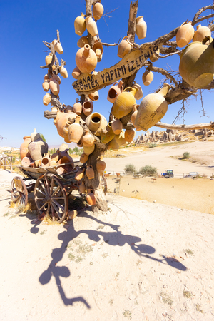 Clay pots on the tree. Rock churches and pigeon lofts. Sword valley, Goreme, Cappadocia, Anatolia, Turkey. Popular attraction
