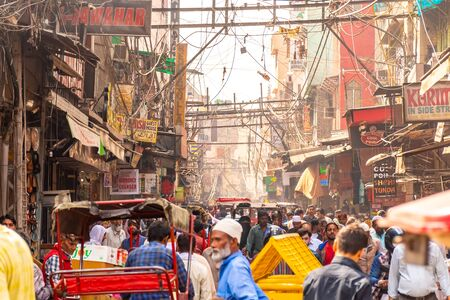 Old Delhi, India, Mar 29 2019 - Overcrowded street in old town with smog, dangerous electric lines close Jama masjid Redakční